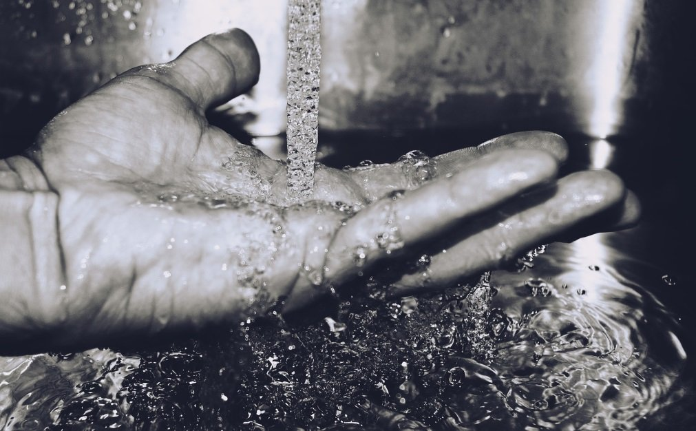 hand in water for wateraid
